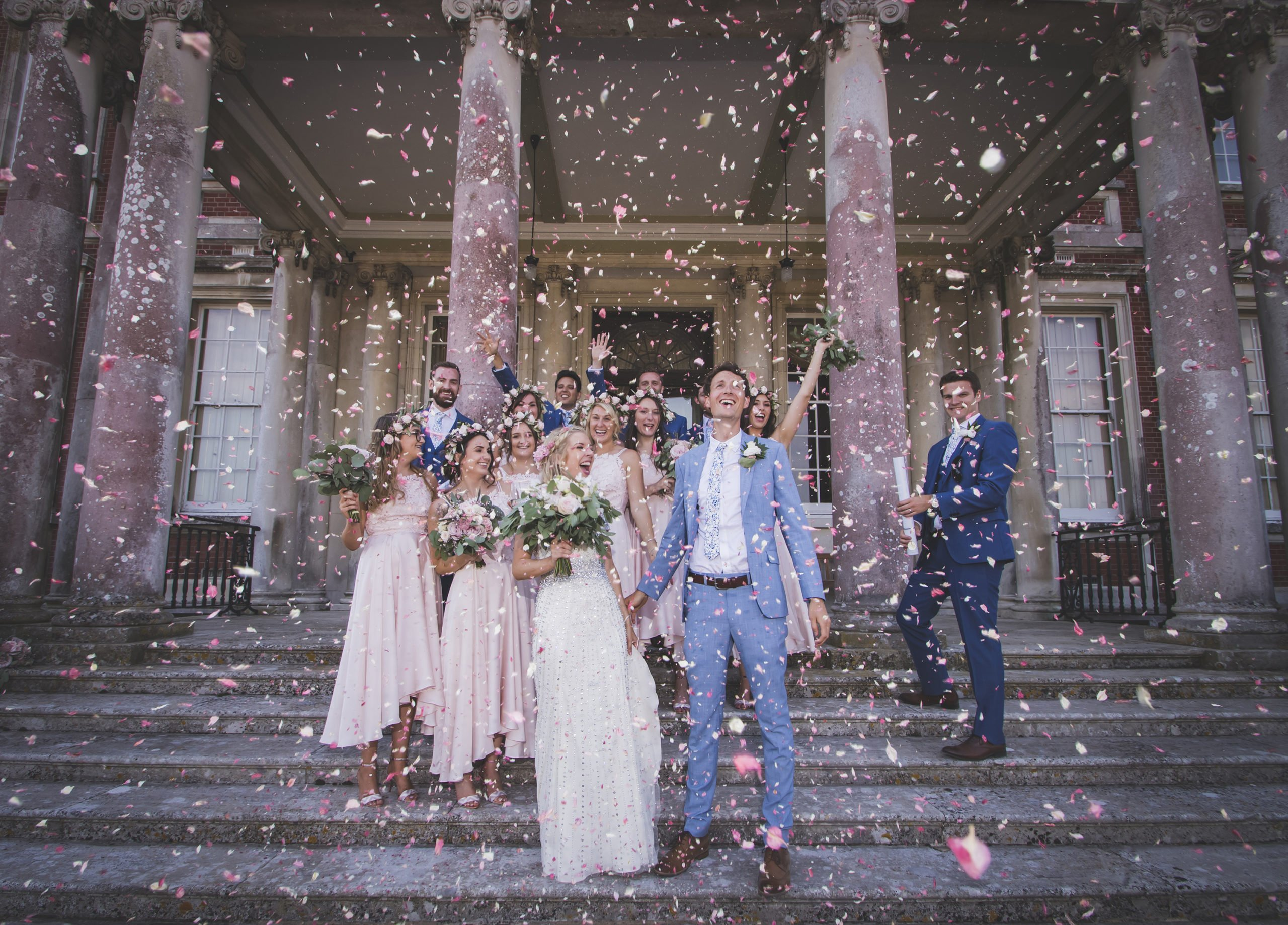 bridal party showered with confetti