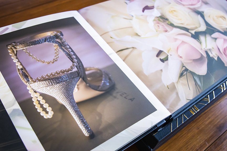 book open showing wedding shoes and flowers