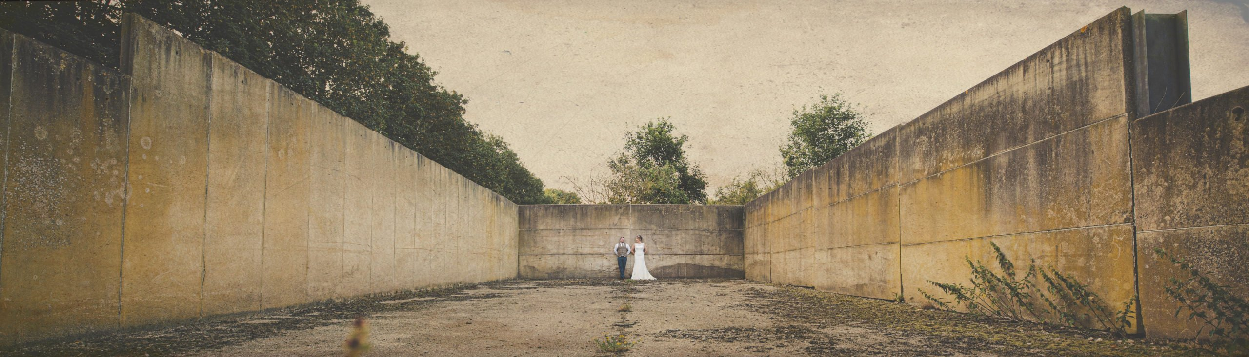 couple standing together in outdoor concrete bunker