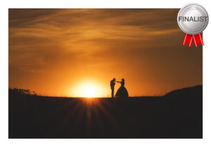 couple silhouetted against sunset